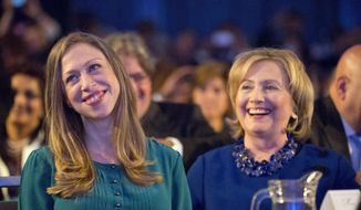 Chelsea Clinton, left, daughter of former President Bill Clinton and former Secretary of State Hillary Rodham Clinton, right, smiles after being acknowledged by President Barack Obama at the Clinton Global Initiative in New York, Tuesday, Sept. 23, 2014. (AP Photo/Pablo Martinez Monsivais) ** FILE **