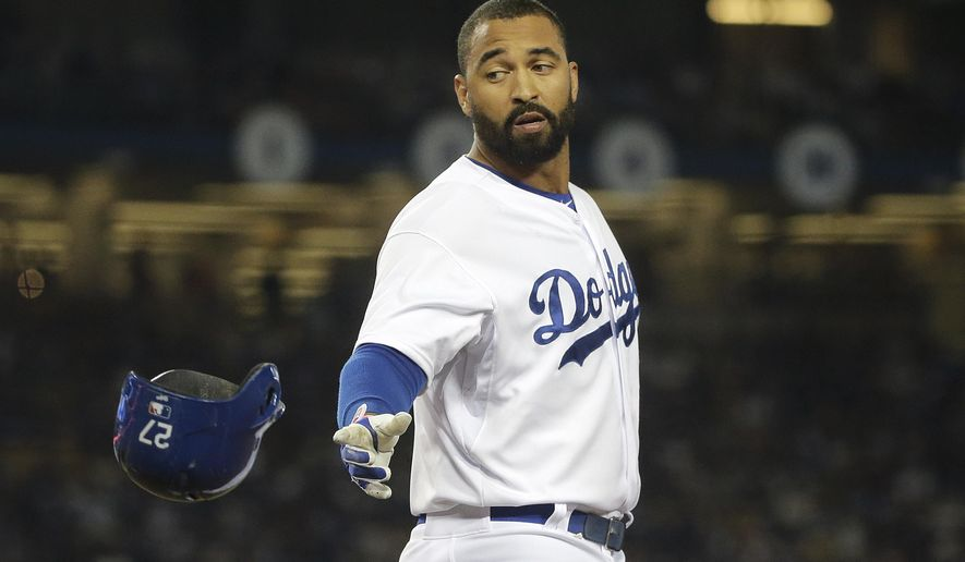 Los Angeles Dodgers' Matt Kemp tosses his helmet to first base coach Davey Lopes after he flied out during the eighth inning of a baseball game against the San Francisco Giants Monday, Sept. 22, 2014, in Los Angeles. (AP Photo/Jae C. Hong)