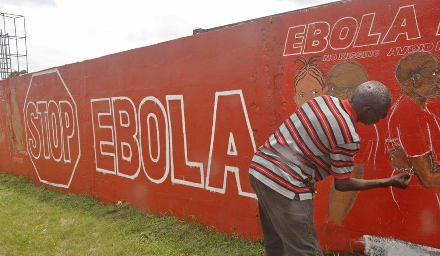 A local Liberian artist paints a mural forming part of the country's fight against the deadly Ebola virus by education in the city of Monrovia, Liberia, Tuesday, Sept. 23, 2014. U.S. health officials Tuesday presented worst-case and best-case scenarios for the Ebola epidemic in West Africa, calculating that as many as 1.4 million people could be sickened in two countries alone by mid-January _ or the outbreak could be winding down by then, if control efforts substantially increase. (AP Photo/Abbas Dulleh)