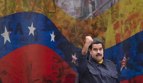 Nicolas Maduro, President of Venezuela, gestures to the crowd before he speaks at Hostos Community College as the United Nations General Assembly convenes, Tuesday, Sept. 23, 2014, in the Bronx borough of New York. (AP Photo/John Minchillo)