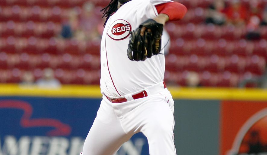 Cincinnati Reds starting pitcher Johnny Cueto throws against the Milwaukee Brewers in the first inning of a baseball game, Tuesday, Sept. 23, 2014, in Cincinnati. (AP Photo/David Kohl)