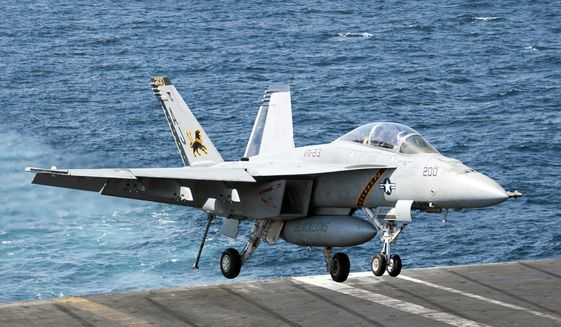In this image provided by the U.S. Navy a F/A-18F Super Hornet attached to the Fighting Black Lions of Strike Fighter Squadron lands aboard the aircraft carrier USS George H.W. Bush in the Persian Gulf on Tuesday, Sept. 23, 2014, after conducting strike missions against Islamic State group targets in Syria. (AP Photo/U.S. Navy, Mass Communication Specialist 3rd Class Brian Stephens)