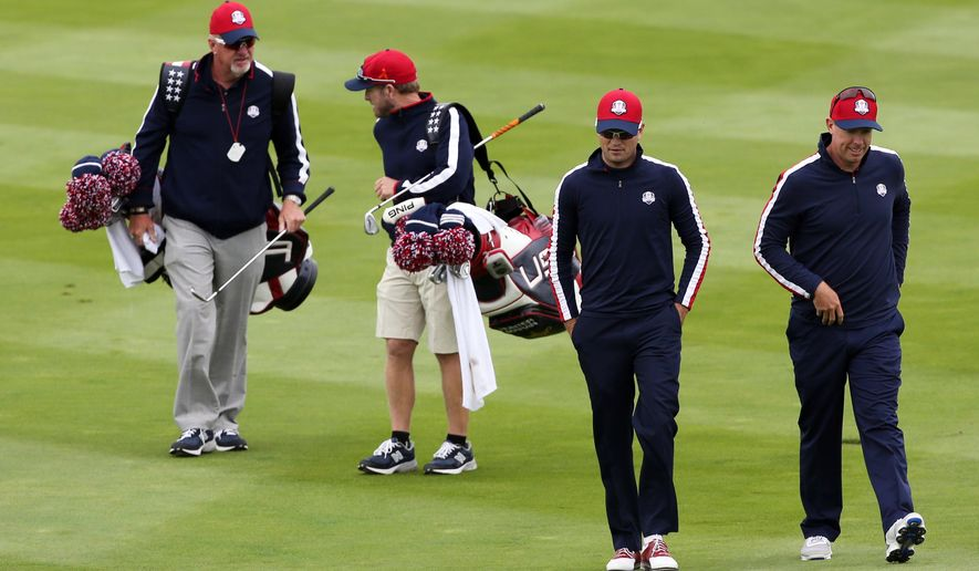 Hunter Mahan, right, and Zach Johnson of the US walk along the 7th fairway with their caddies during a practice round ahead of the Ryder Cup golf tournament at Gleneagles, Scotland, Tuesday, Sept. 23, 2014. (AP Photo/Scott Heppell)