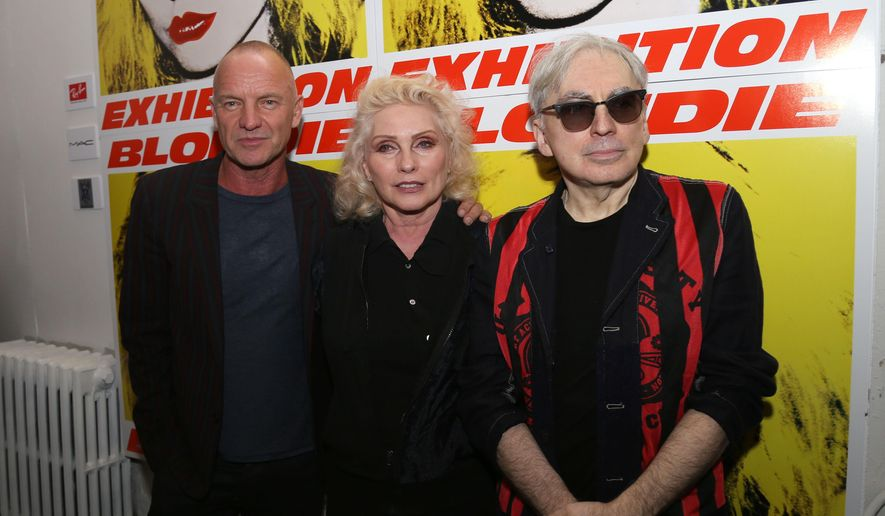 From left, Sting, Debbie Harry and Chris Stein attend Blondie's 40th Anniversary Art Exhibit at the Chelsea Hotel on Monday, Sept. 22, 2014 in New York. (Photo by Greg Allen/Invision/AP)