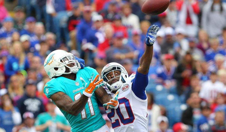 FILE - In this Sept. 14, 2014, file photo, Buffalo Bills cornerback Corey Graham (20) breaks up a pass intended for Miami Dolphins wide receiver Mike Wallace (11) during the first half of an NFL football game  in Orchard Park, N.Y. The Dolphins are still having trouble getting the ball to speedy Mike Wallace deep, which is one reason they've lost their past two games. (AP Photo/Bill Wippert, File)
