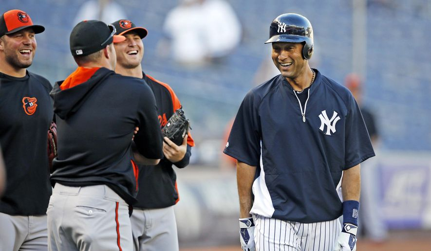 New York Yankees shortstop Derek Jeter, right, chats with members of the Baltimore Orioles during batting practice before a baseball game between the two teams at Yankee Stadium in New York, Tuesday, Sept. 23, 2014. (AP Photo/Kathy Willens)