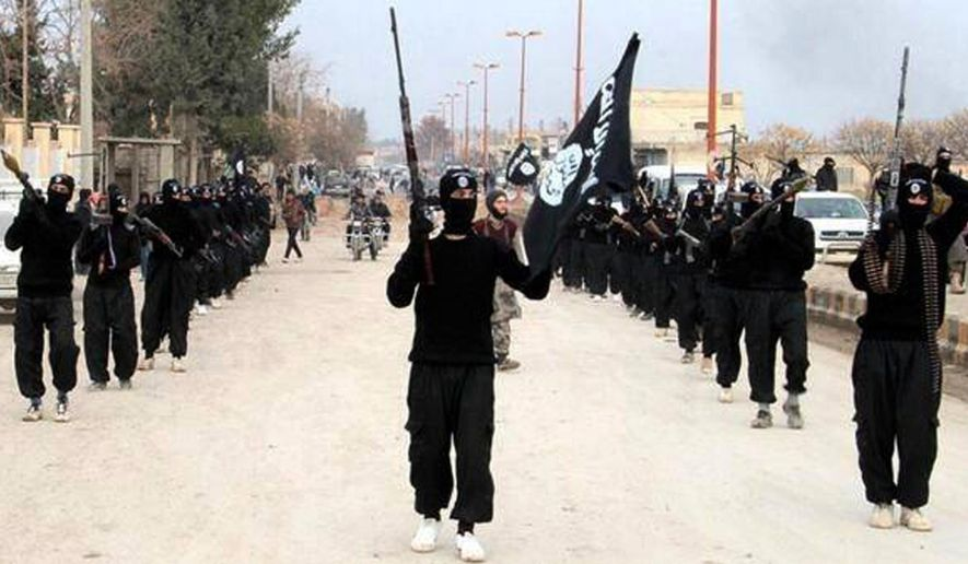 This undated file image posted on a militant website on Tuesday, Jan. 14, 2014, which has been verified and is consistent with other AP reporting, shows fighters from the Islamic State group marching in Raqqa, Syria. (AP Photo/Militant Website, File)