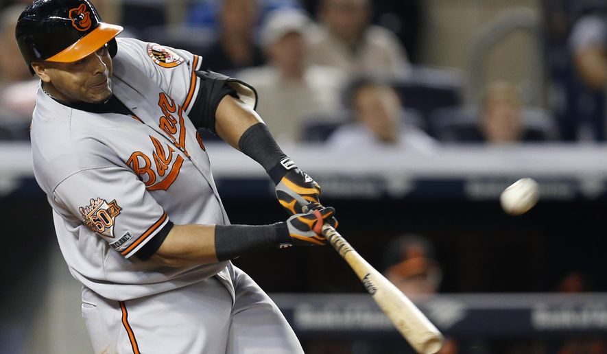 Baltimore Orioles designated hitter Nelson Cruz hits a fifth-inning solo home run off New York Yankees starting pitcher Brandon McCarthy in a baseball game at Yankee Stadium in New York, Tuesday, Sept. 23, 2014. (AP Photo/Kathy Willens)