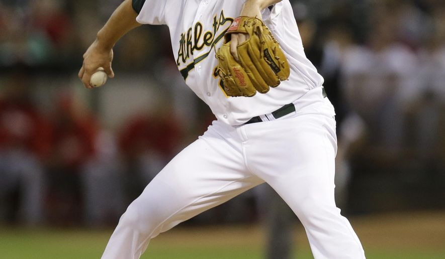 Oakland Athletics' Jeff Samardzija works against the Los Angeles Angels in the first inning of a baseball game Monday, Sept. 22, 2014, in Oakland, Calif. (AP Photo/Ben Margot)