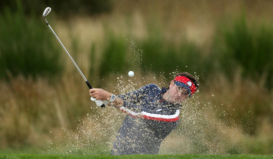 Bubba Watson of the US plays out of a bunker onto the 12th fairway during a practice round ahead of the Ryder Cup golf tournament at Gleneagles, Scotland, Tuesday, Sept. 23, 2014. (AP Photo/Peter Morrison)