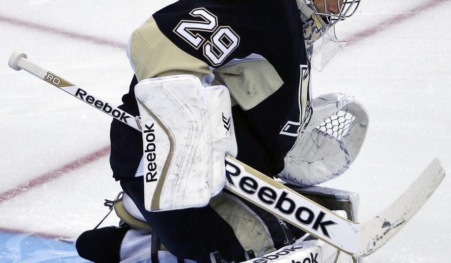 Pittsburgh Penguins goalie Marc-Andre Fleury (29) blocks shot in the first period of a NHL pre-season hockey game against the Detroit Red Wings in Pittsburgh Monday, Sept. 22, 2014. The Red Wings won 2-1. (AP Photo/Gene J. Puskar)