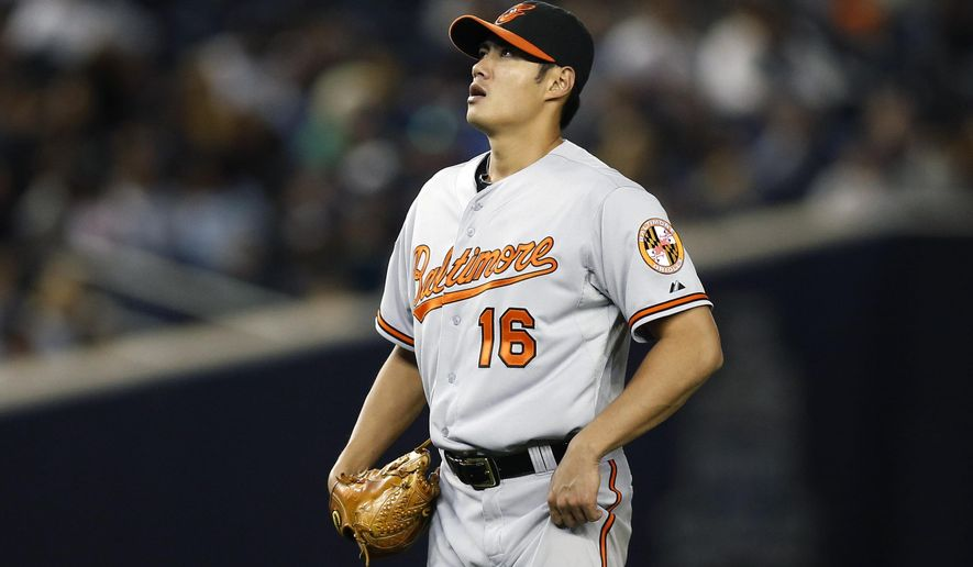 Baltimore Orioles starting pitcher Wei-Yin Chin reacts after allowing a fifth-inning, two-run double to New York Yankees Derek Jeter in the Orioles 5-0 shutout loss to the Yankees in a baseball game against the New York Yankees at Yankee Stadium in New York, Monday, Sept. 22, 2014.  (AP Photo/Kathy Willens)