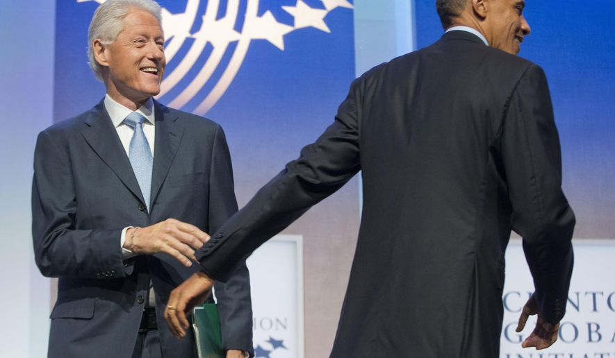 President Barack Obama is greeted by former President Bill Clinton at the Clinton Global Initiative in New York, Tuesday, Sept. 23, 2014. Obama is in New York for three days of talks with foreign leaders at the annual United Nations General Assembly. (AP Photo/Pablo Martinez Monsivais)