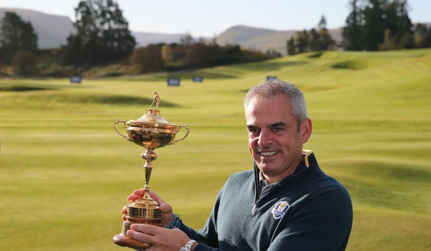 Europe team captain Paul McGinley holds the Ryder Cup trophy ahead of the Ryder Cup golf tournament at Gleneagles, Scotland, Tuesday, Sept. 23, 2014. (AP Photo/Scott Heppell)