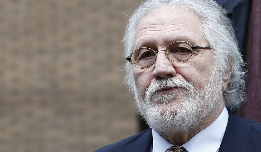 FILE -  This is a Thursday, Feb. 13, 2014 file photo of British veteran disc jockey Dave Lee Travis leaves Southwark Crown Court in London.  A jury has found veteran British DJ Dave Lee Travis guilty of indecent assault.  The 69-year-old Travis, whose real name is David Griffin, was cleared on two other assault charges on Tuesday Sept. 23, 2014. (AP Photo/Lefteris Pitarakis, File)