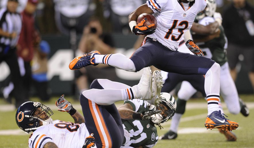 Chicago Bears wide receiver Rashad Ross (13) leaps over teammate tight end Dante Rosario (88) and New York Jets defensive back Ellis Lankster (31) in the first quarter of an NFL football game, Monday, Sept. 22, 2014, in East Rutherford, N.J. (AP Photo/Bill Kostroun)