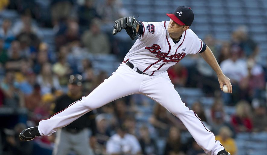 Atlanta Braves starting pitcher Alex Wood winds up during the first inning of a baseball game against the Pittsburgh Pirates on Tuesday, Sept. 23, 2014, in Atlanta. (AP Photo/John Bazemore)