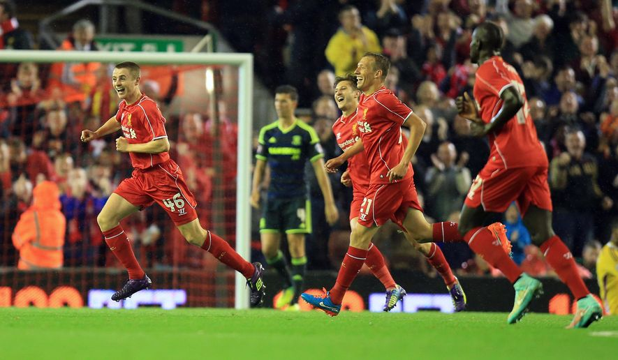 Liverpool's Jordan Rossiter, left, celebrates the opening goal during the English League Cup Third Round match Liverpool against Middlesbrough at Anfield, Liverpool, England, Tuesday Sept. 23, 2014. (AP Photo/PA, Peter Byrne) UNITED KINGDOM OUT  NO SALES  NO ARCHIVE