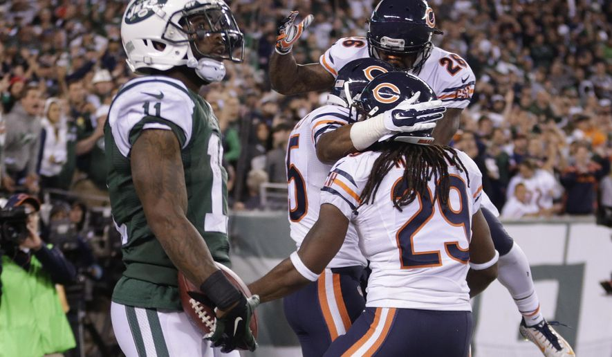 The Chicago Bears celebrate after breaking up a pass in the end zone to New York Jets wide receiver Jeremy Kerley (11) during the fourth quarter of an NFL football game, Monday, Sept. 22, 2014, in East Rutherford, N.J. The Bears won 27-19. (AP Photo/Julio Cortez)