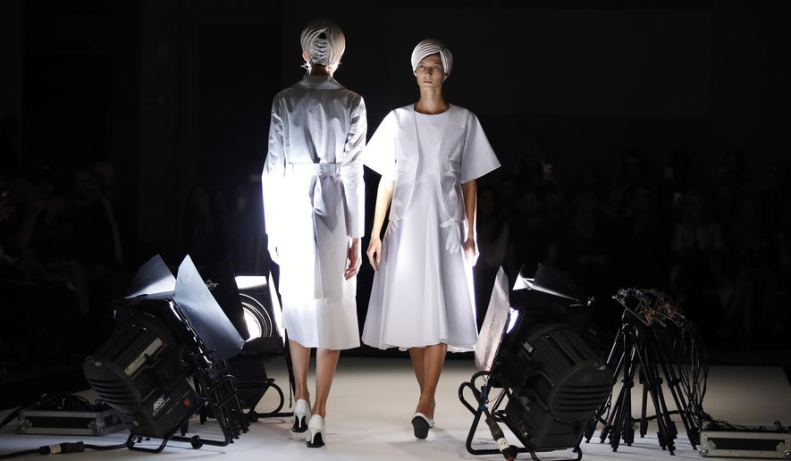 Models present creations by Japan's fashion designer Kunihiko Morinaga for Anrealage's Spring-Summer 2015 ready-to-wear fashion collection presented in Paris, France, Tuesday, Sept. 23, 2014. (AP Photo/Francois Mori)
