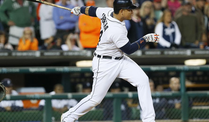 Detroit Tigers' Miguel Cabrera watches his walk off one-run single against the Chicago White Sox in the ninth inning of a baseball game in Detroit Tuesday, Sept. 23, 2014. Detroit won 4-3. (AP Photo/Paul Sancya)
