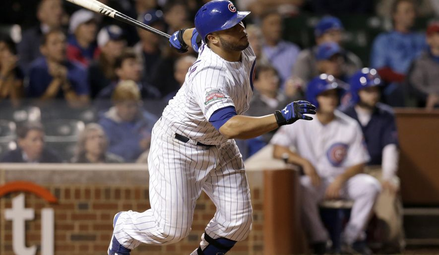 Chicago Cubs' Welington Castillo watches his game-winning single off St. Louis Cardinals relief pitcher Pat Neshek during the 10th inning of a baseball game Tuesday, Sept. 23, 2014, in Chicago. Anthony Rizzo scored the winning run. The Cubs won 4-3. (AP Photo/Charles Rex Arbogast)