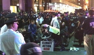 "More than 100 activists were arrested Monday in New York City during ""Flood Wall Street,"" a protest against what organizers say is the corporate world's contribution to climate change. (Twitter/@FloodWallStreet)"