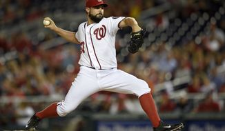 Washington Nationals starting pitcher Tanner Roark delivers a pitch against the New York Mets during the third inning of a baseball game, Tuesday, Sept. 23, 2014, in Washington. (AP Photo/Nick Wass)