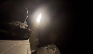 In this photo released by the U.S. Navy, the guided-missile destroyer USS Arleigh Burke (DDG 51) launches Tomahawk cruise missiles, in the Arabian Gulf, Tuesday, Sept. 23, 2014. Syria said Tuesday that Washington informed President Bashar Assad's government of imminent U.S. airstrikes against the Islamic State group, hours before an American-led military coalition pounded the extremists' strongholds across northern and eastern Syria. (AP Photo/Carlos M. Vazquez II, U.S. Navy)
