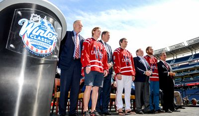 Left to right: Washington Capitals Senior Vice President and General Manager Brian MacLellan, Center Nicklas Backstrom,  Monumental Sports & EntertainmentPresident Dick Patrick, Washington Capitals Captain Alex Ovechkin, NHL Commissioner Gary Bettman, Goaltender Braden Holtby, and Washington Capitals Chairman & Owner Ted Leonsis pose for photographs for the 2015 Bridgestone NHL Winter Classic held at Nationals Park, Washington, D.C., Tuesday, September 23, 2014. (Andrew Harnik/The Washington Times)