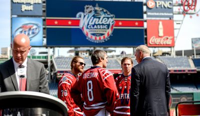 Washington Capitals Senior Vice President and General Manager Brian MacLellan, right, speaks with Washington Capitals Captain Alex Ovechkin, center, Center Nicklas Backstrom, left, and Goaltender Braden Holtby, second from right, speak together following a press conference announcing the 2015 Bridgestone NHL Winter Classic held at Nationals Park, Washington, D.C., Tuesday, September 23, 2014. (Andrew Harnik/The Washington Times)