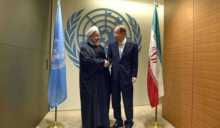 UN Secretary-General Ban Ki-moon, right, greets Iranian President Hassan Rouhani before a meeting at the United Nations Tuesday, Sept 23, 2014, on the sidelines of the 69th Session of the UN General Assembly. (AP Photo/Jewel Samad, Pool)