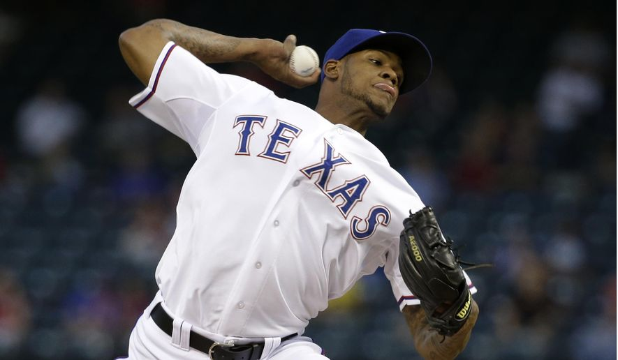 Texas Rangers pitcher Lisalverto Bonilla delivers to the Houston Astros in the first inning of a baseball game, Wednesday, Sept. 24, 2014, in Arlington, Texas. (AP Photo/Tony Gutierrez)