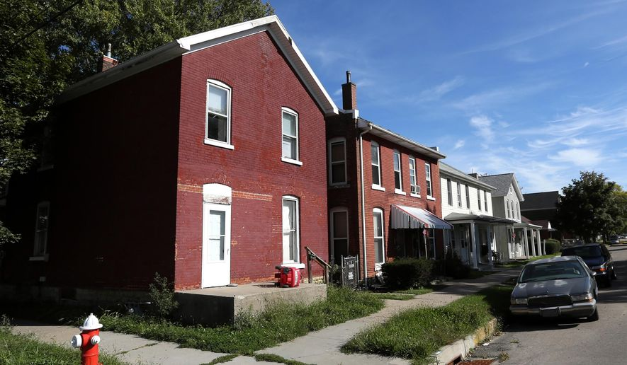 This photo taken on Tuesday, Sept. 23, 2014, shows a home at1598 Washington Street in Dubuque, Iowa. Dubuque plans to spend $4 million to buy, rehab and sell more than 50 houses near the city's downtown area. (AP Photo/The Telegraph Herald, Jessica Reilly) MAGS OUT, TV OUT