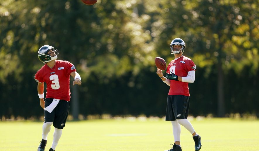 Philadelphia Eagles quarterback Mark Sanchez (3) and quarterback Nick Foles (9) run a drill during NFL football practice at the team's training facility, Tuesday, Sept. 23, 2014, in Philadelphia. (AP Photo/Matt Rourke)