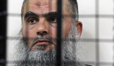 The radical al Qaeda-linked preacher Abu Qatada sits behind bars at the Jordanian military court in Amman, Jordan, in this, June 26, 2014 file photo. A Jordanian military court acquitted radical Muslim preacher Abu Qatada Wednesday Sept. 24, 2014 on terrorism charges for his role in plotting attacks against Americans and Israelis. The court ruled there was insufficient evidence against Abu Qatada and his defense lawyer, Husein Mubaidin, says he expects his client to be released within hours. (AP Photo/Raad Adayleh, File)