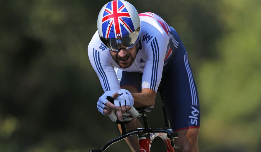 New world champion Britain's Bradley Wiggins competes to win the men's individual time trial event over 47.1 kilometers (29.3 miles) at the Road Cycling World Championships in Ponferrada, north-western Spain, Wednesday Sept. 24, 2014. (AP Photo/Daniel Ochoa de Olza)