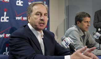"""FILE - In this Jan. 24, 2012, file photo, Washngton Wizards president Ernie Grunfeld, left, joined by coach Randy Wittman, speaks to reporters in Washington. It's been a while since the Wizards opened training camp as a team expected to make the playoffs. Even so, the men who have overseen the turnaround are cautious more than bullish as they prepare for the start of training camp next week. Grunfeld on Wednesday, Sept. 24, 2014, proclaimed the Eastern Conference as """"wide open,"""" yet he settled for home-court advantage in the first round of the playoffs as something that """"would be a good accomplishment"""" for his team. (AP Photo/Manuel Balce Ceneta, File)"""