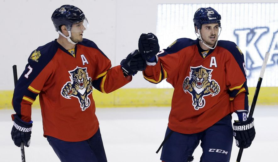 Florida Panthers center Dave Bolland (63) is congratulated by teammate Dmitry Kulikov (7) after Bolland scored against the Dallas Stars in the second period of an NHL hockey preseason game, in Sunrise, Fla., Wednesday, Sept. 24, 2014. (AP Photo/Alan Diaz)