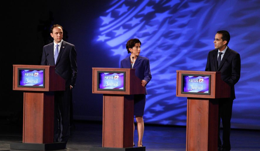 FILE - In this Tuesday, June 10, 2014, file photo, from left, R.I. 2014 gubernatorial candidates Clay Pell, R.I. Treasurer Gina Raimondo and Providence Mayor, Angel Taveras debate at the Providence Performing Arts Center in Providence, R.I. An analysis of TV ad spending in state races shows Rhode Island had the highest per-voter spending in the country, with an estimated $5.8 million shelled out before the 2014 primary. (AP Photo/The Providence Journal, Kris Craig, Pool, File)