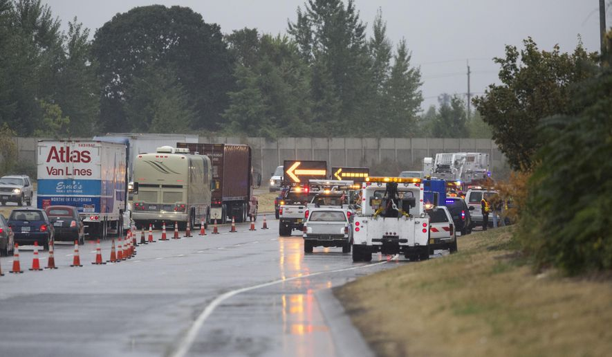 Traffic is diverted as emergency crews work at the scene of a multiple-car crash, just south of the Portland Road overpass, in the southbound lanes of Interstate 5, Wednesday, Sept. 24, 2014, in Salem Ore.(AP Photo/The Oregonian,  Randy L. Rasmussen)  MAGS OUT; TV OUT; LOCAL TELEVISION OUT; LOCAL INTERNET OUT; THE MERCURY OUT; WILLAMETTE WEEK OUT; PAMPLIN MEDIA GROUP OUT