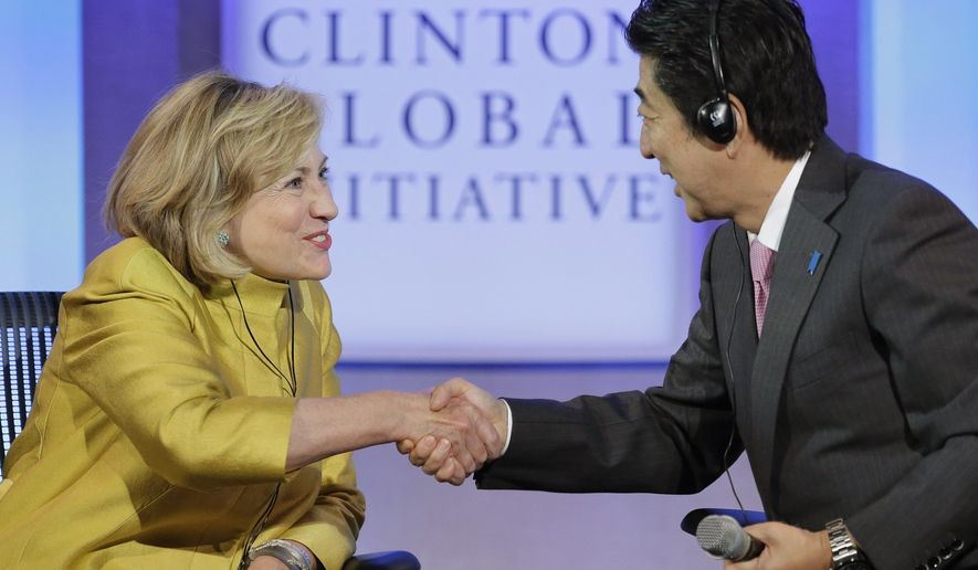 "Former U.S. Secretary of State Hillary Rodham Clinton, left, thanks Japanese Prime Minister Shinzo Abe for participating in the discussion, ""Equality for Girls and Women: 2034 Instead of 2134?"" at the Clinton Global Initiative, Wednesday, Sept. 24, 2014, in New York. (AP Photo/Mark Lennihan)"