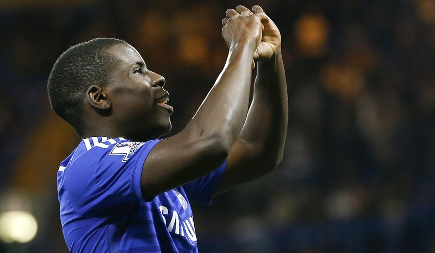 Chelsea's Kurt Zouma celebrates scoring a goal during the English League Cup soccer match between Chelsea and Bolton Wanderers at Stamford Bridge Stadium in London, Wednesday, Sept. 24, 2014. (AP Photo/Kirsty Wigglesworth)