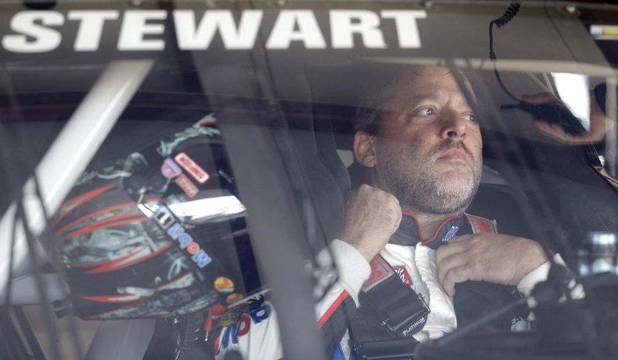 FILE - In this Sept. 13, 2014, file photo, NASCAR driver Tony Stewart (14) sits in his car during final practice for the NASCAR Sprint Cup Series auto race at Chicagoland Speedway in Joliet, Ill. An upstate New York grand jury has finished hearing testimony regarding Tony Stewart's role in the on-track death of sprint car driver Kevin Ward. The Ontario County District Attorney will announce the findings at 3 p.m. Eastern Wednesday, Sept. 24, 2014. (AP Photo/Nam Y. Huh, File)