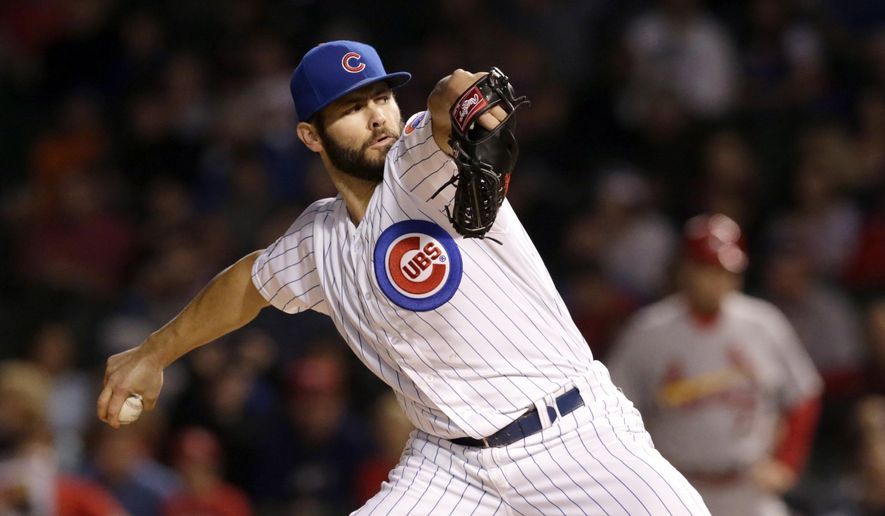 Chicago Cubs starting pitcher Jake Arrieta delivers during the first inning of a baseball game against the St. Louis Cardinals, Wednesday, Sept. 24, 2014, in Chicago. (AP Photo/Charles Rex Arbogast)