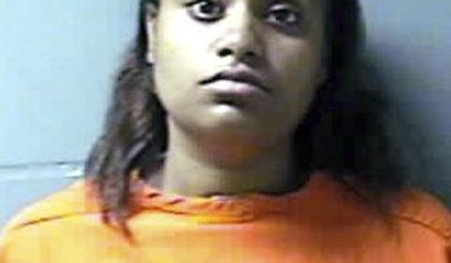 FILE - This June 2014, file photo, provided by the Westchester County Department of Correction, shows Nicole Diggs. A Westchester County judge ruled this week that a detective's testimony to the grand jury that indicted Nicole Diggs and Oscar Thomas was inaccurate in several respects. The judge also said the detective improperly suggested that the girl's $2 million trust fund was a motive in her death. Diggs, 32, a special education teacher, and Thomas, 29, who married after the girl's death, had pleaded not guilty after being charged with negligent homicide and child endangerment in the 2012 death in Yonkers of 8-year-old Alayah Savarese. (AP Photo/Westchester County Department of Correction, File)