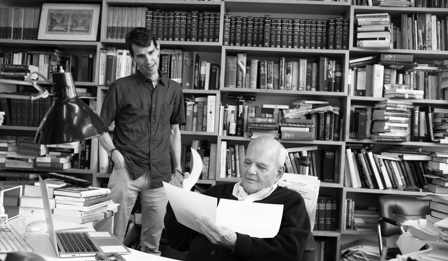 "This photo released by HBO shows Hugh Eakin, left, and Robert Silvers, in a scene from the documentary, ""The Fifty Year Argument: An Inside Look at The New York Review of Books,"" which airs on HBO on Sept. 29, 2014. The film mixes archival footage with contemporary interviews, scenes from the Review's office and highlights from an anniversary celebration at Town Hall in Manhattan in 2013. The film is co-directed by Scorsese and David Tedeschi, who edited Scorsese's documentaries on Bob Dylan and George Harrison. (AP Photo/Courtesy HBO)"
