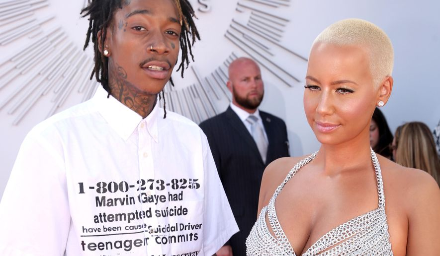 FILE - In this Sunday, Aug. 24, 2014 file photo, Wiz Khalifa, left, and Amber Rose arrive at the MTV Video Music Awards at The Forum in Inglewood, Calif. Rose filed for divorce from Khalifa on Tuesday, Sept. 23, 2014, in Los Angeles. The model cited irreconcilable differences as the reason for the couple's breakup after a year of marriage. (Photo by Matt Sayles/Invision/AP, file)