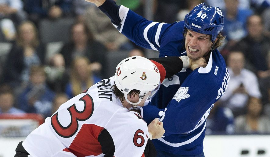 Toronto Maple Leafs forward Troy Bodie, right, fights Ottawa Senators defenseman Alex Grant (63) during the second period of an NHL preseason hockey game Wednesday, Sept. 24, 2014, in Toronto. (AP Photo/The Canadian Press, Nathan Denette)