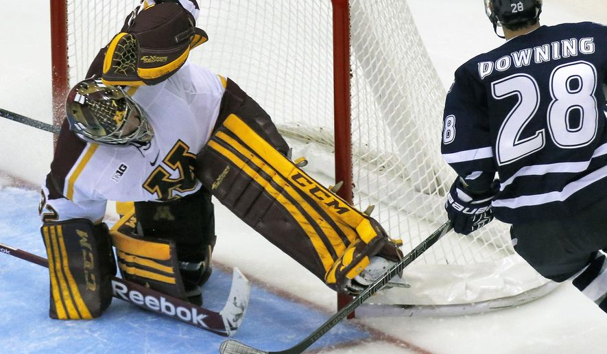 In this Oct. 12, 2013, photo, Minnesota goalie Adam Wilcox makes a save against New Hampshire in a college hockey game in Minneapolis. Minnesota has been picked first in the Big Ten hockey preseason poll by conference coaches. The Big Ten announced the poll Wednesday, Sept. 24,2014, at its media day in Detroit. (AP Photo/Star Tribune, Marlin Levison)
